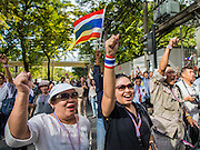 "29 NOVEMBER 2013 - BANGKOK, THAILAND: Anti-government chant ""Long Live the King!"", as they march past the US Embassy in Bangkok. The protestors support the monarchy and are opposed the elected government. Several thousand Thai anti-government protestors marched on the US Embassy in Bangkok. They blew whistles and asked the US to honor their efforts to unseat the elected government of Yingluck Shinawatra. The anti-government protestors marched through several parts of Bangkok Friday paralyzing traffic but no clashes were reported, even after a group protestors tried to occupy Army headquarters.         PHOTO BY JACK KURTZ"