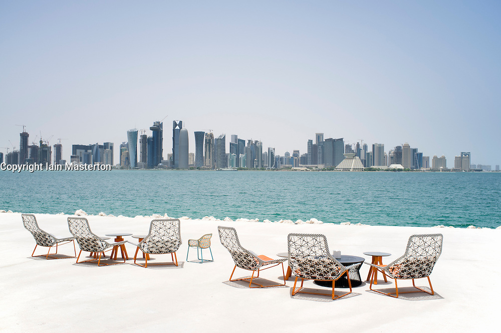 Modern Furniture Qatar modern outdoor seating at waterfront cafe with view of skyline of