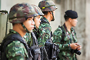 "20 MAY 2104 - BANGKOK, THAILAND: Thai soldiers at an army checkpoint at the National Police headquarters on Rama I Road in Bangkok. The army has taken over public security functions from the police and ordered many of the police units to stand down. The Thai Army declared martial law throughout Thailand in response to growing political tensions between anti-government protests led by Suthep Thaugsuban and pro-government protests led by the ""Red Shirts"" who support ousted Prime Minister Yingluck Shinawatra. Despite the declaration of martial law, daily life went on in Bangkok in a normal fashion. There were small isolated protests against martial law, which some Thais called a coup, but there was no violence.  PHOTO BY JACK KURTZ"