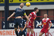 10th August 2019; Dens Park, Dundee, Scotland; SPFL Championship football, Dundee FC versus Ayr; Jamie Ness of Dundee competes in the air with Kris Doolan of Ayr United