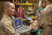 A multi-national medical team, including American, Dutch, British, Canadian and Australian doctors and nurses work to save an young Afghan girl caught in combat cross-fire.