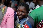 Nkhata Bay, Lake Malawi, Malawi, Southern Africa..Young traditional woman turns around from watching a dance and music gathering on the banks of Lake Malawi...© Demelza Cloke.DVD001