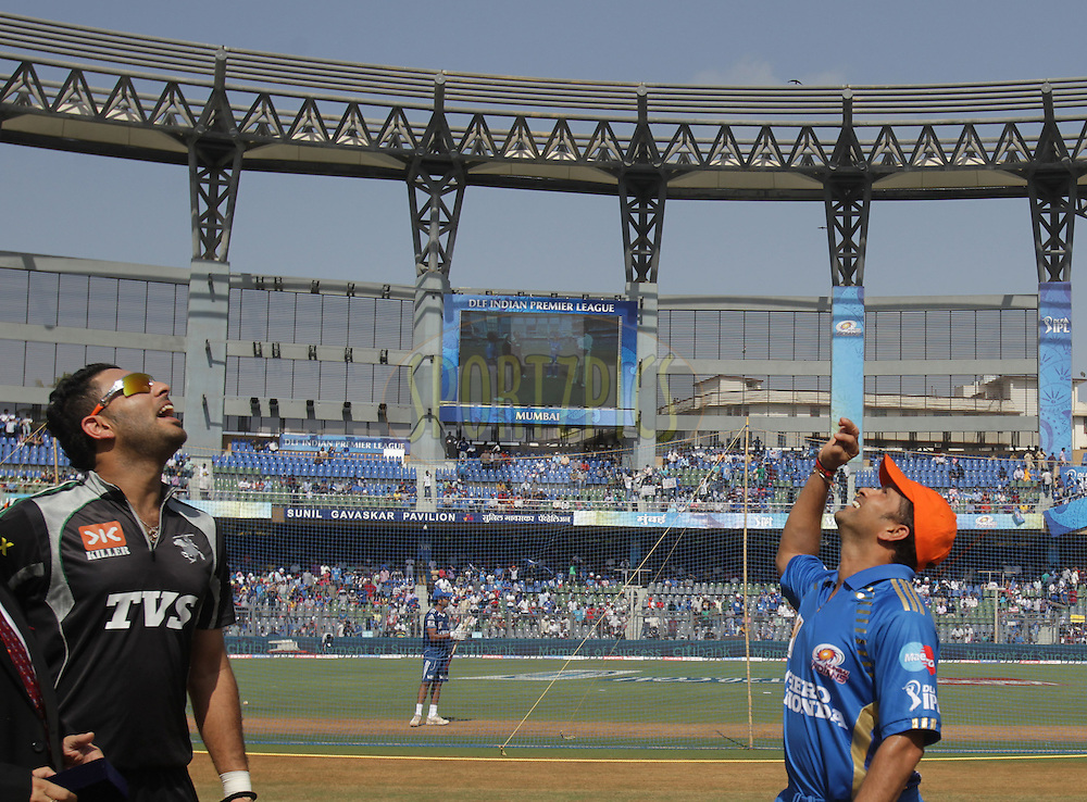 Mumbai Indian captain Sachin Tendulkar and Pune Warriors captain Yuvraj Singh during the toss of the match 21 of the Indian Premier League ( IPL ) Season 4 between the Mumbai Indians and the Pune Warriors held at the Wankhede Stadium, Mumbai, India on the 20th April 2011..Photo by BCCI/SPORTZPICS.