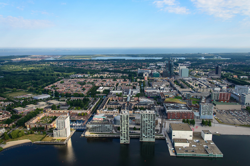 Nederland, Flevoland, Almere, 27-08-2013; centrum met Weerwater, Apollohotel  en de Schouwburg Almere aan de Esplanade. Midden foto hoogbouw van WTC en Rabobank. Aan de horizon het IJmeer/Markermeer en de skyline Amsterdam.<br /> Heart of the newly constructed city of Almere, the theater Almere and the Apollo hotel on the border of the Weerwater (lake). In the back the skyline of Amsterdam<br /> luchtfoto (toeslag op standaard tarieven);<br /> aerial photo (additional fee required);<br /> copyright foto/photo Siebe Swart.