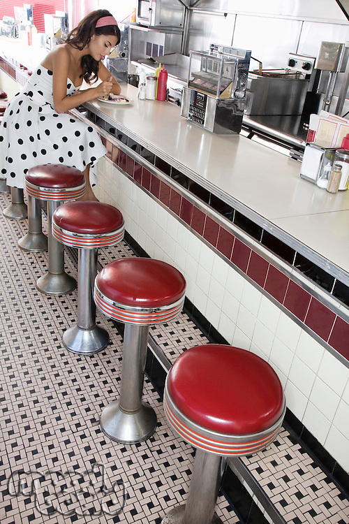 Young Woman Sitting at a Diner Counter