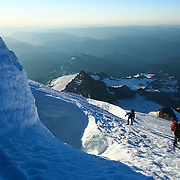Climbers make their way around a crevasse during a summit of Mount Rainier on June 30, 2015. The iconic Pacific Northwest volcano is a popular challenge for mountaineers.  (Joshua Trujillo, seattlepi.com)