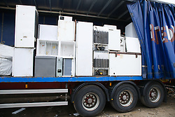 EndofLife fridges stacked up on a lorry arriving at a collection centre for safe and environmentally sound breakdown,