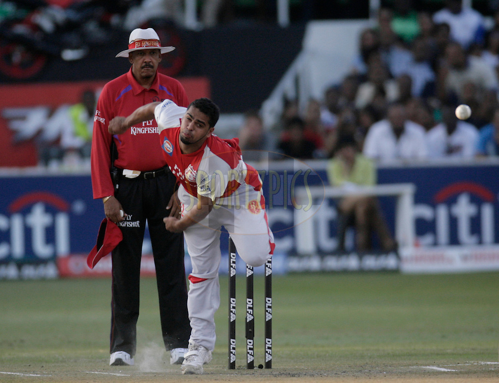 DURBAN, SOUTH AFRICA - 24 April 2009. Yusuf Abdulla bowls during the IPL Season 2 match between the Royal Challengers Bangalore and the Kings X1 Punjab held at Sahara Stadium Kingsmead, Durban, South Africa..