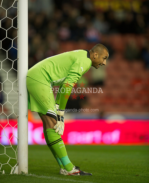 STOKE-ON-TRENT, ENGLAND - Tuesday, September 20, 2011: Tottenham Hotspur's goalkeeper Heurelho Gomes looks dejected during the Football League Cup 3rd Round match against Stoke City at the Britannia Stadium. (Pic by David Rawcliffe/Propaganda)