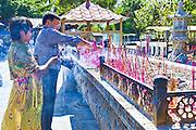 Lighting incense sticks. Nanshan Buddhism Culture Park. Sanya, Hainan province of southern China. 15//2/2012