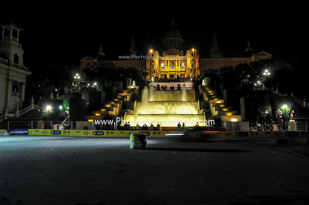 The illuminated cascading fountains in front of the National Art Museum of Catalonia, Barcelona, Spain