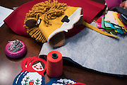 Supplies lay on the table where Molly Goodall creates children's jackets she designs at her home in McKinney, Texas on September 11, 2015. (Cooper Neill for The New York Times)