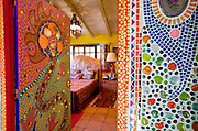 San Miguel de Allende, Guanajuato, Mexico: The bedroom doors and surrounding walls are decorated with tiles, beads, and dot art. The color palate includes electric green and hot pink. It is on an acre of land outside San Miguel Allende, Mexico. June 2009. (photo: Ann Summa)..
