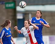 Farmington's Megan McCarthy wins an aerial duel with Spartans' Laura Gavin - Forfar Farmington v Spartans in the Scottish Womens Premier League at Station Park, Forfar. Photo: David Young<br /> <br />  - © David Young - www.davidyoungphoto.co.uk - email: davidyoungphoto@gmail.com