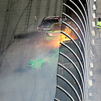 NASCAR Sprint Cup driver Danica Patrick (10)  wrecks after crossing the finish line during the NASCAR Coke Zero 400 Sprint series auto race at the Daytona International Speedway on Saturday, July 6, 2013 in Daytona Beach, Florida.  (AP Photo/Alex Menendez)