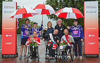 Brian Alldis (GBR) second place winner, Walter Ablinger (AUT) the first placed rider and Heinz Freil (SUI) the third placed rider with presenters  Cathy Lewis Executive Director Prudential UK and Europe and Leon Daniles Managing Director Surface Transport at Transport for London at the medal ceremony for the Mens Handcycle Classic at Prudential RideLondon, the world's greatest festival of cycling, involving 70,000+ cyclists – from Olympic champions to a free family fun ride - riding in five events over closed roads in London and Surrey over the weekend of 9th and 10th August. <br /> <br /> Photo: Neil Turner for Prudential Ride London<br /> <br /> Sunday 10th August 2014<br /> <br /> See www.PrudentialRideLondon.co.uk for more.<br /> <br /> For further information: Penny Dain 07799 170433<br /> pennyd@ridelondon.co.uk