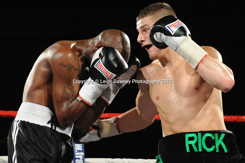 Ricky Skelton(Pro debut fight -black/green shorts) defeats Jason Nesbitt in a 4x3 min Light Middleweight contest at the Bowlers Exhibition Centre, Manchester, on the 2nd June 2012. Frank Maloney Promotions © Leigh Dawney Photography 2012.
