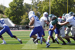 17 September 2011: Steve Rivera looks for a running lane as Cameron McGlynn closes in during an NCAA Division 3 football game between the Aurora Spartans and the Illinois Wesleyan Titans on Wilder Field inside Tucci Stadium in.Bloomington Illinois.