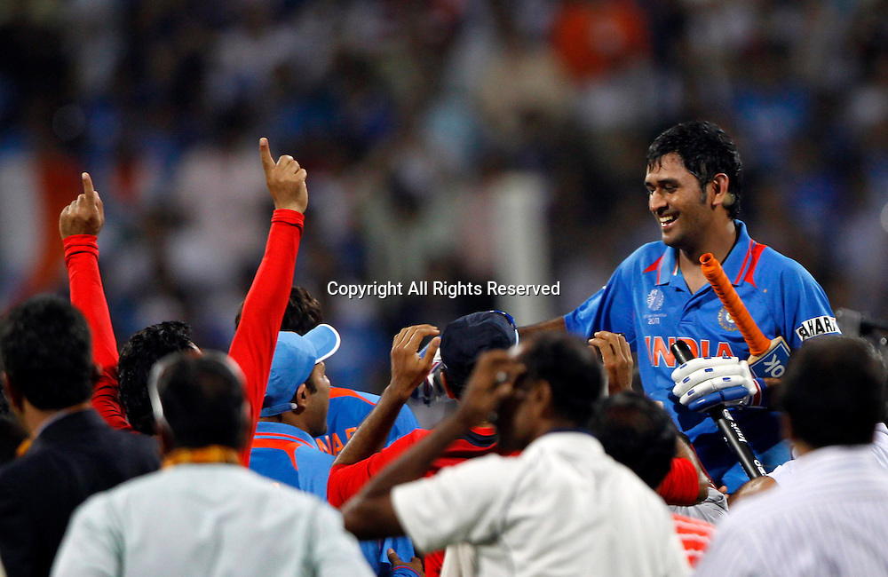 02.04.2011 Cricket World Cup Final from the Wankhede Stadium in Mumbai. Sri Lanka v India. Indian Captain Mahendra Singh Dhoni  celebrates as they win the final match of the ICC Cricket World Cup between India and Sri Lanka on the 2nd April 2011