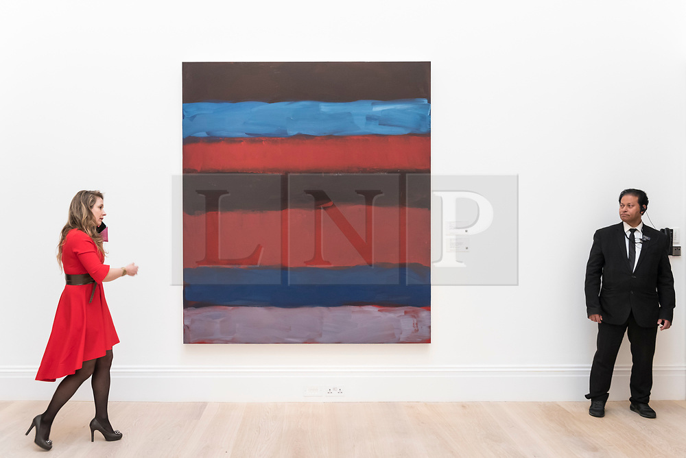 """© Licensed to London News Pictures. 01/03/2019. LONDON, UK. A visitor walks by """"Landline Red Blue"""", 2015, by Sean Scully, (Est. £700,000 - 1,000,000).  Preview of Sotheby's Contemporary Art Sale in their New Bond Street galleries.  Works by artists including Tracey Emin, Jenny Saville, Jean-Michel Basquiat and Andy Warhol will be offered for auction on 5 March 2019.  Photo credit: Stephen Chung/LNP"""