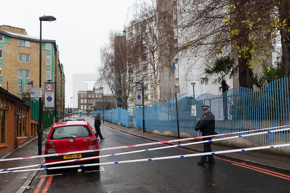 © Licensed to London News Pictures. 03/01/2015. London, UK. Police cordon in place near Stelfox House in Penton Rise, Islington. Police have launched a murder investigation after two men were found dead following a suspicious house fire in Penton Rise in Islington, north London last night. Photo credit : Vickie Flores/LNP