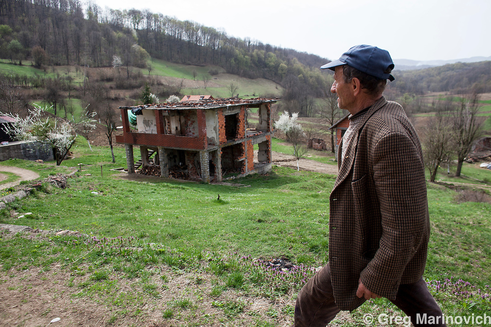 Bosnia and Herzegovina, April 4, 2012. Hasim Music in Kusonje, in the mountains outside Zvornik in Central Bosnia, Republika Srpska, was an almost entirely Moslem village of 100 families in 80 homes that was almost entirely destroyed by extremist Serb Chetnik fighters after some 36  men - including Music - were sent to Batkovic concetration camp in Bijeljinja and the woemn and children expelled to Bosnian held Tuzla in 1992. 8 of the men were killed at the camp, and the twenty elderly who decided to remian in the village were never seen again. Some 30 families returned in 2000. Greg Marinovich