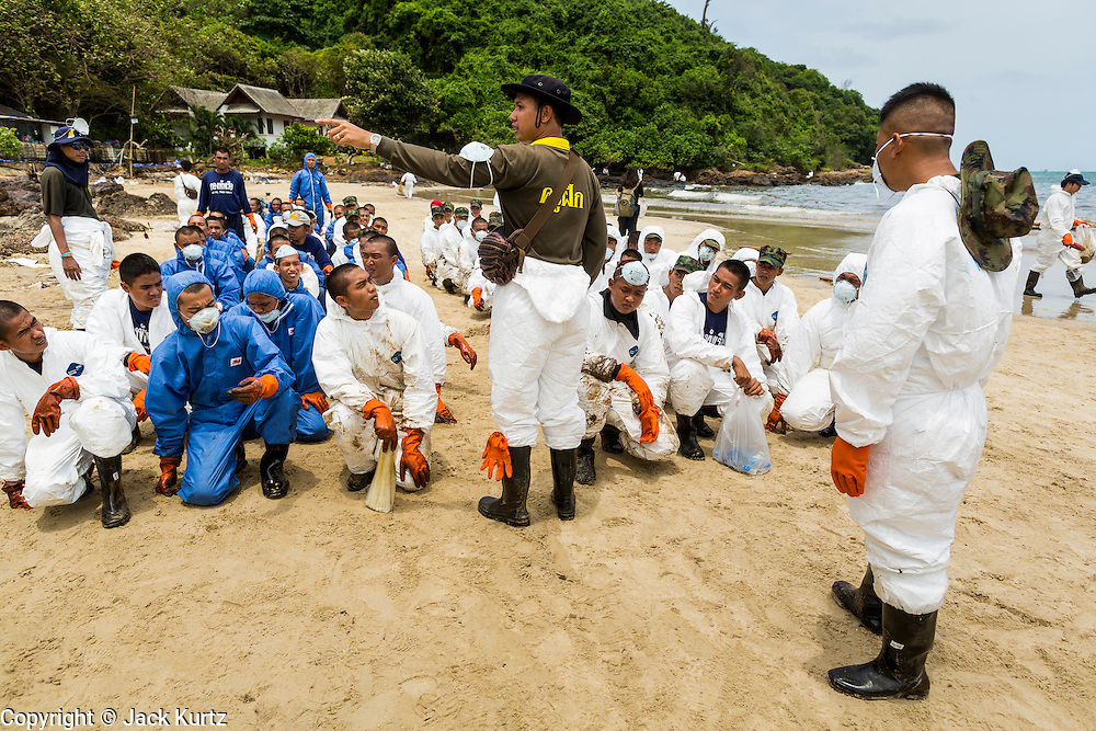 02 AUGUST 2013 - KOH SAMET, RAYONG, THAILAND: Members of the Royal Thai Navy are briefed on cleanup procedures before they go to work on oil contaminated Ao Prao beach on Koh Samet island. About 50,000 liters of crude oil poured out of a pipeline in the Gulf of Thailand over the weekend authorities said. The oil made landfall on the white sand beaches of Ao Prao, on Koh Samet, a popular tourist destination in Rayong province about 2.5 hours southeast of Bangkok. Workers from PTT Global, owner of the pipeline, up to 500 Thai military personnel and volunteers are cleaning up the beaches. Tourists staying near the spill, which fouled Ao Prao beach, were evacuated to hotels on the east side of the island, which was not impacted by the spill. Officials have not said when Ao Prao beach would reopen. PTT Global Chemical Pcl is part of state-controlled PTT Pcl, Thailand's biggest energy firm.    PHOTO BY JACK KURTZ