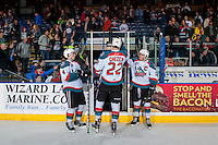 KELOWNA, CANADA - FEBRUARY 13: Braydyn Chizen #22 exits the ice between Gordie Ballhorn #4 and Rodney Southam #17 of the Kelowna Rockets after the win against the Seattle Thunderbirds on February 13, 2017 at Prospera Place in Kelowna, British Columbia, Canada.  (Photo by Marissa Baecker/Shoot the Breeze)  *** Local Caption ***