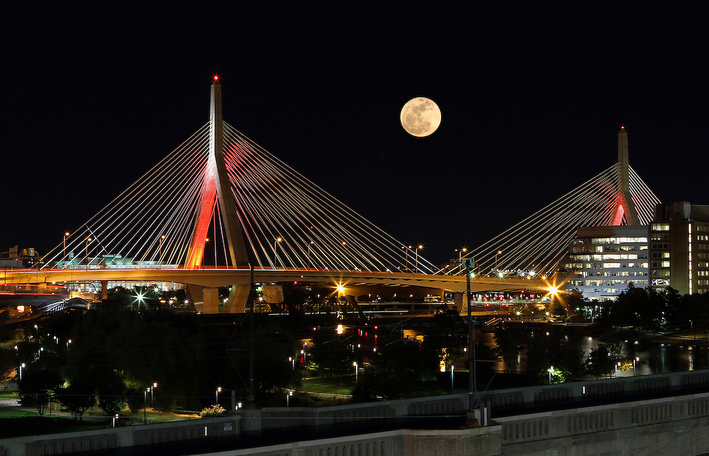 New England nature and astrology photography of a rising full moon over the iconic Boston Zakim Bridge. It is always a special treat and pleasure to experiencing and photographing a full moon.<br />