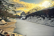 Hirosaki castle in nothern Japan.The moat is frozen and it is very cold.