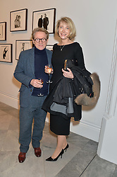 JOHN PAWSON and his wife CATHERINE at a private view of photographs by David Bailey entitled 'Bailey's Stardust' at the National Portrait Gallery, St.Martin's Place, London on 3rd February 2014.