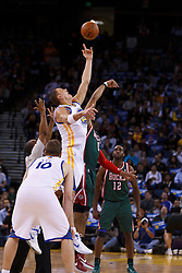 Mar 16, 2012; Oakland, CA, USA; Golden State Warriors power forward David Lee (10) wins the opening tip off against the Milwaukee Bucks during the first quarter at Oracle Arena. Milwaukee defeated Golden State 120-98. Mandatory Credit: Jason O. Watson-US PRESSWIRE
