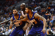 Nov 15, 2013; Phoenix, AZ, USA; Phoenix Suns forward Marcus Morris (15) and forward Markieff Morris (11) box out Brooklyn Nets forward Kevin Garnett (2) at US Airways Center. The Nets defeated the Suns 100-98 in overtime. Mandatory Credit: Jennifer Stewart-USA TODAY Sports