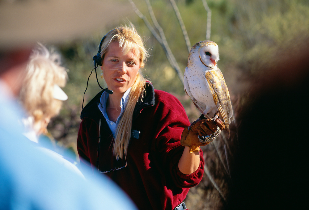 350130-1000B ~ Copyright: George H.H. Huey ~ Ornithologist, Sue Tygielski, w/ barn owl [part of Free Flight program]. Arizona-Sonora Desert Museum, Arizona.