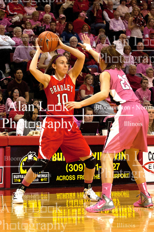 12 February 2012:  Katie Broadway keeps Katie Yohn beyond the 3 point line during an NCAA women's basketball game Where the Bradley Braves lost to the Illinois Sate Redbirds 82-63.  It was Play 4Kay day in honor of the cancer research fund set up by Coach Kay Yow at Redbird Arena in Normal IL