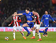 Leicester City defender Harry Maguire (15) takes on Sheffield United midfielder John Fleck (4)  and Sheffield United defender Danny Lafferty (24) during the The FA Cup match between Leicester City and Sheffield Utd at the King Power Stadium, Leicester, England on 16 February 2018. Picture by Jon Hobley.