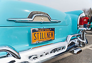 This blue Classic Ford Mercury. with 'STILL NEW' license plates, is in the 58th Annual Easter Sunday Vintage Car Parade and Show sponsored by the Garden City Chamber of Commerce. Hundreds of authentic old motorcars, 1898-1988, including antiques, classic, and special interest participated in the parade.