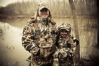 YOUNG GIRL AND BOY DUCK HUNTERS