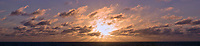 Panorama of the Morning Sun and Clouds over the Atlantic Ocean. Composite of 22 images taken with a Nikon 1 V3 camera and 70-300 mm VR lens