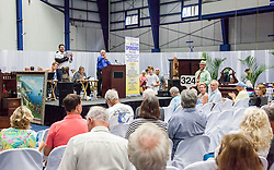 Auctioneer George Blackhall accepts a final bid.  The Hebrew Congregation of St. Thomas presents its seventeenth annual Antiques, Art & Collectibles at Antilles' MCM Center.  The annual silent and live auction supports upkeep and maintenance of the Historic Synangogue and its community programs.   St. Thomas, USVI.  21 February 2016.  © Aisha-Zakiya Boyd