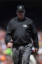 SAN FRANCISCO, CA - MAY 02:  MLB umpire Bill Miller #26 walks across the field to review a play during the fifth inning between the San Francisco Giants and the Los Angeles Angels of Anaheim at AT&T Park on May 2, 2015 in San Francisco, California.  The San Francisco Giants defeated the Los Angeles Angels of Anaheim 5-4. (Photo by Jason O. Watson/Getty Images) *** Local Caption *** Bill Miller