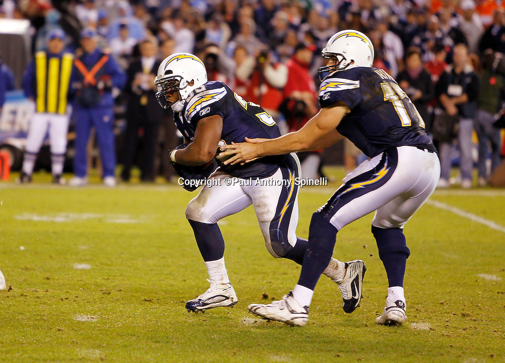 San Diego Chargers quarterback Philip Rivers (17) hands off the ball to San Diego Chargers fullback Mike Tolbert (35) during the NFL week 11 football game against the Denver Broncos on Monday, November 22, 2010 in San Diego, California. The Chargers won the game 35-14. (©Paul Anthony Spinelli)