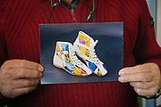 Cefal&ugrave;: Francesco Liberto alias Ciccio, il calzolaio dei piloti di formula 1 iscritto dall&rsquo;UNESCO fra i Tesori Umani Viventi nel Libro dei Saperi del Registro delle Eredit&agrave; Immateriali con una delle sue creazioni .<br /> Cefal&ugrave;: Francesco Liberto also known as Ciccio in his shop, Ciccio the shoemaker of racing drivers, registered with the UNESCO Living Human Treasures in the Book of Knowledge of the Register of Intangible Heritage, in his hands a photo of onepair of  his racing shoes