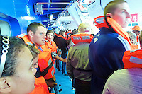 Evacuation/Lifeboat Drill. Image taken with a Leica V-Lux 30 camera (ISO 400, 4.3 mm, f/4, 1/15 sec)