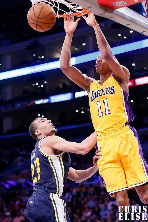 19 March 2015: Los Angeles Lakers forward Wesley Johnson (11) dunks the ball over Utah Jazz center Rudy Gobert (27) during the Utah Jazz 80-73 victory over the Los Angeles Lakers, at the Staples Center, Los Angeles, California, USA.