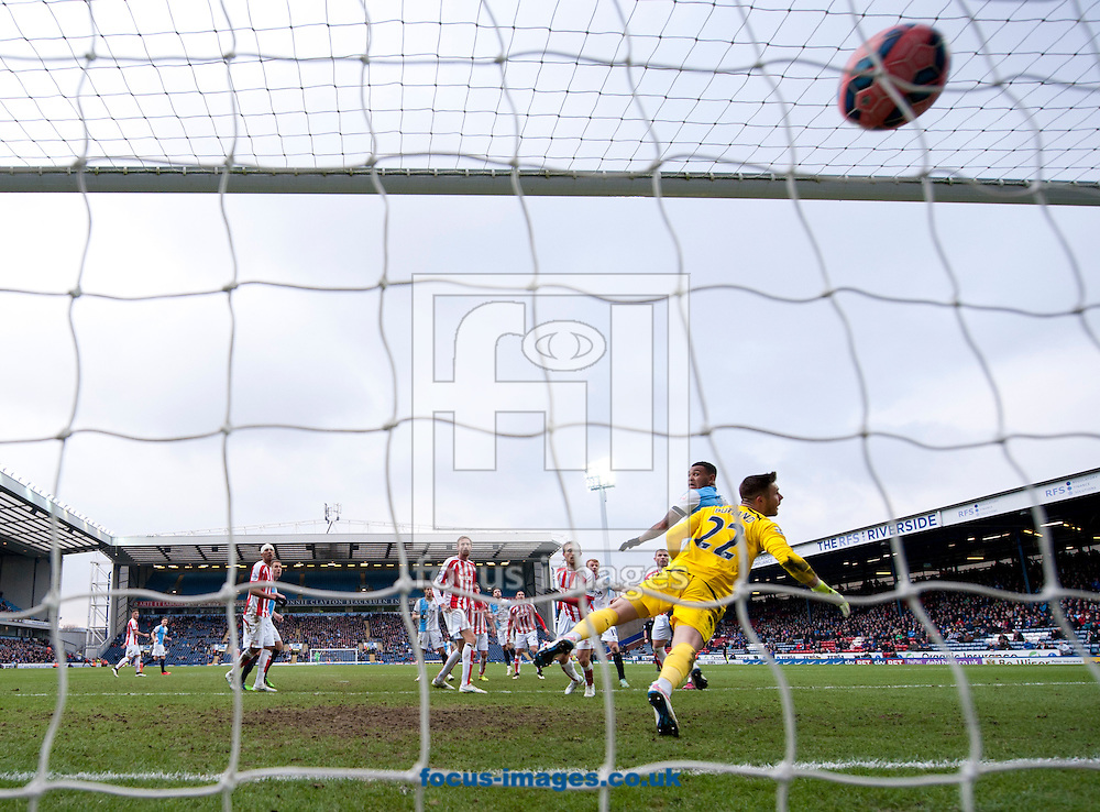 Joshua King of Blackburn Rovers heads past Stoke City goalkeeper Jack Butland to make it 1-1 during the FA Cup match at Ewood Park, Blackburn<br /> Picture by Russell Hart/Focus Images Ltd 07791 688 420<br /> 14/02/2015