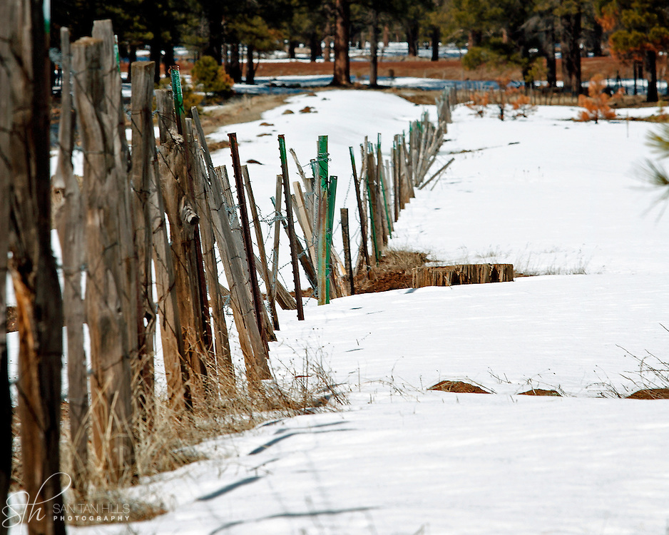 Wooden posts in the snow of late winter - Northern Arizona
