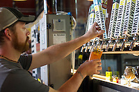 Drew Frechette, tap room manager at Wormtown Brewery, fills a pint of Bottle Rocket Pale Ale at the tap room in Worcester, Massachusetts on August 28, 2015.  Matthew Healey for The Boston Globe<br /> <br /> (MAGAZINE Story Editor Francis Storrs, Assigning editor Jim Wilson, Visuals editor Lloyd Young)