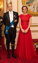 ALTERNATE CROP<br /> The Duke and Duchess of Cambridge arrive for the annual evening reception for members of the Diplomatic Corps at Buckingham Palace, London.
