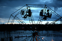 Kids ride a Ferris wheel at dusk next to the Atrato River in Quibdo, the capital of the state of Choco, on October 6, 2006. Choco is a state that has suffered terribly at the hands of both rightwing paramilitaries and leftist rebels over the years, causing many to flee to other parts of Colombia. The Choco is located on the Pacific coast of Colombia and most of the people are black descendants of African slaves. (Photo/Scott Dalton).
